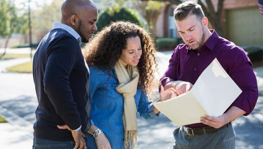 Three people looking over a document together