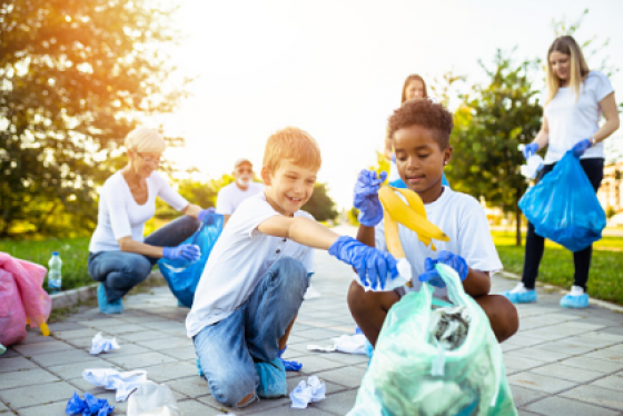 Children participating in a park cleanup