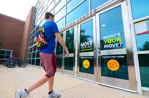 Image of a student walking into the recreation center.