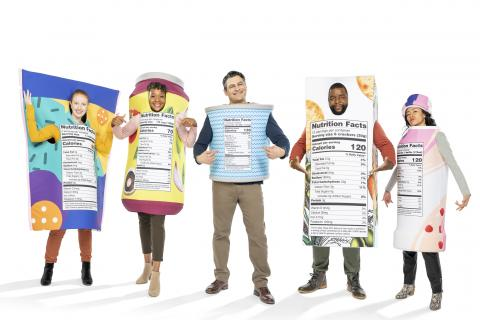 Men and women dressed in New FDA Nutritional label costumes