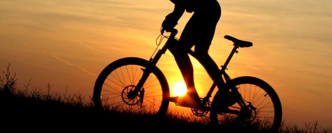 Silhouette of cyclist in sunset