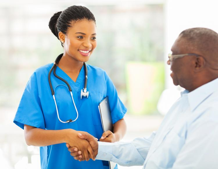 Health care provider shaking man's hand