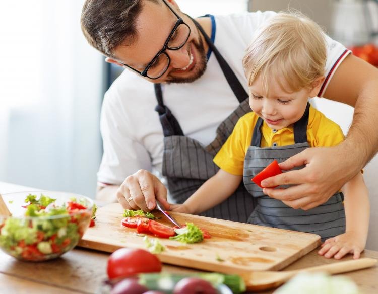 Father and son preparing vegetables for a nutritious meal