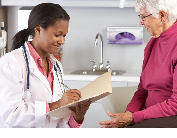 Health care provider talking with woman