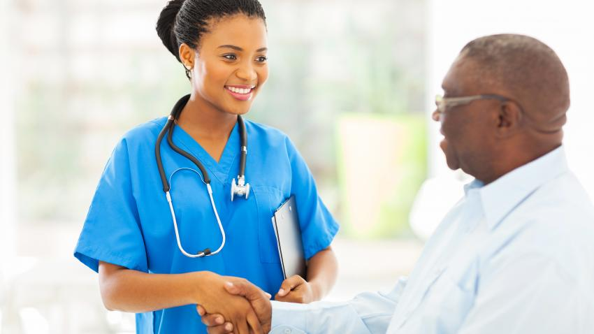 Health care provider shaking man's hand