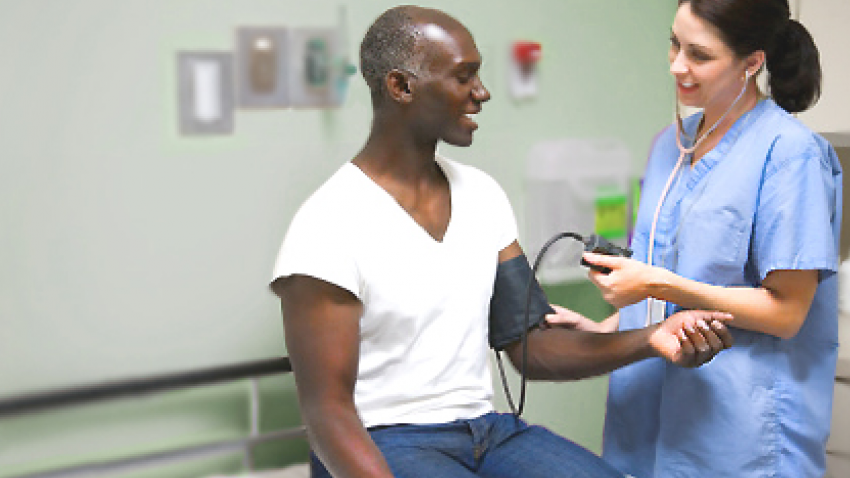 Man getting his blood pressure checked by health care provider