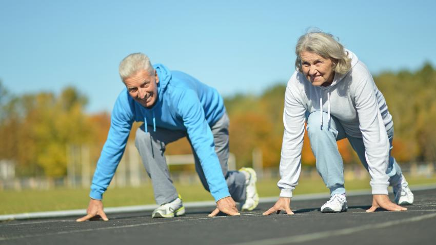 Older man and woman stretching