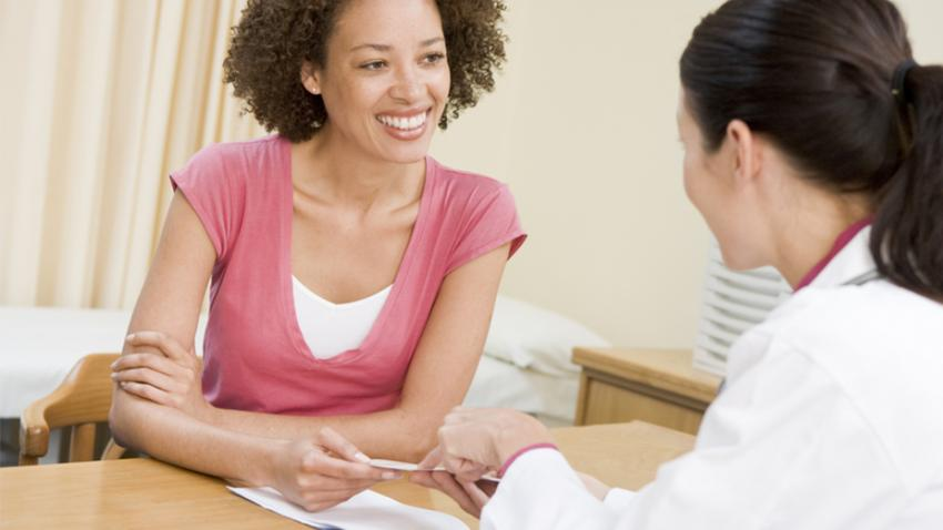 Woman talking with health care provider