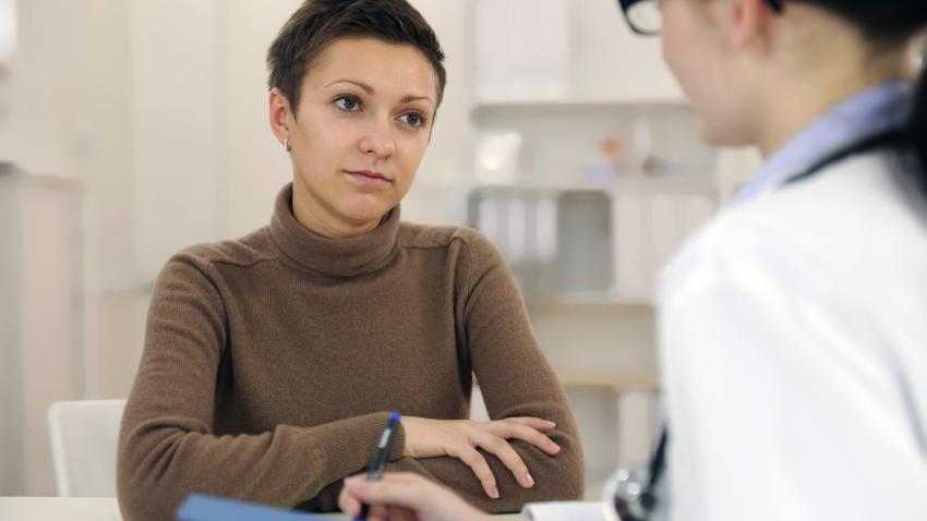 Woman speaking with provider